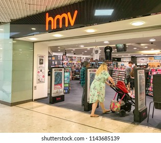 SWANSEA, WALES  - JULY 2018: Customer entering a branch of HMV in the Quadrant shopping centre in Swansea city centre.