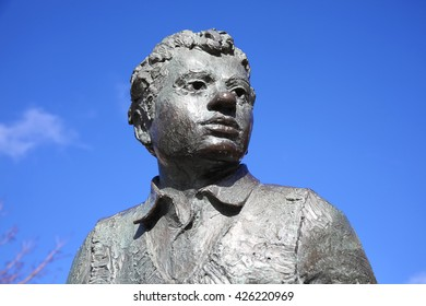 Swansea, Wales, UK, February 23, 2016 : Dylan Thomas statue which stands outside the Dylan Thomas Theatre in the Marina. which was unveiled in 1984 as a memorial to the much loved poet and write