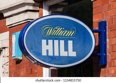Swansea, Wales, UK, June 30, 2018 : William Hill logo advertising sign outside its betting shop in St Helen's Road
