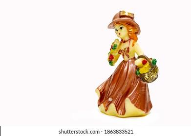 Swap meet. Vintage figurines of young ladies, in a long dress, faience figurines.