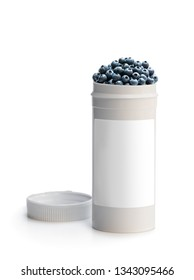 Swap  your pills to a fresh blueberry. Concept of nature made vitamin supplement from natural berries