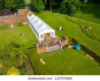 SWARLING MANOR WEDDING VENUE, KENT / UK - MAY 26 2018: Aerial views of a wedding set in the beautiful grounds of Swarling Manor, located in Kent, the garden of England.