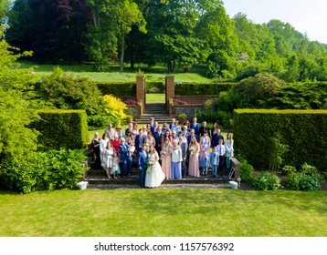 SWARLING MANOR WEDDING VENUE, KENT / UK - MAY 26 2018: Aerial views of a wedding party in the beautiful grounds of Swarling Manor, located in Kent, the garden of England.