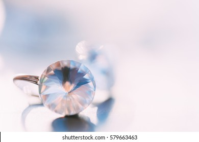 Swarovsky diamond necklace and earrings on an orchid flower