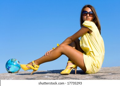 Swarthy young girl poses on the beach