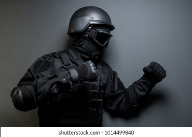 SWAT in black uniform, face mask and bulletproof vest. Russian special forces. Tactical helmet vest goggles. Spec ops Riot police officer Defense and protection of law enforcement officers.