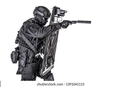 SWAT fighter hiding behind ballistic shield on white