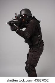 SWAT police officer with assault gun.
