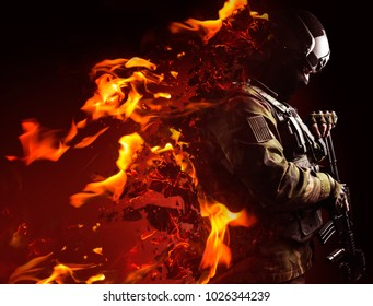 Swat soldier with flame effects. Profile view photo of a swat soldier with fire dissolving effect on black background.