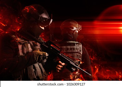 Swat soldiers posing in fire. Photo of a swat soldiers posing with automatic rifle in flame effects.