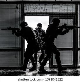 SWAT team breaching door and storming apartments
