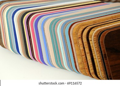 Swatch of plastic counter top samples on a white background.