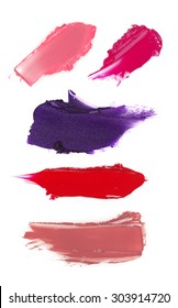 Swatches of lipstick smeared on white