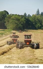 Swathers working a grass hay field near Salem Oregon.