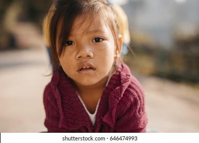 Swayambhunath, KATHMANDU, NEPAL - NOVEMBER 19, 2016 : Nepalese cute little girl at Swayambhunath temple in Kathmandu.