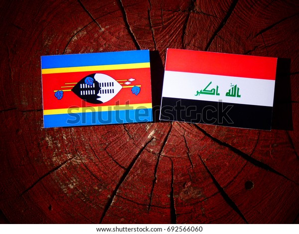 Swaziland flag with Iraqi flag on a tree stump isolated