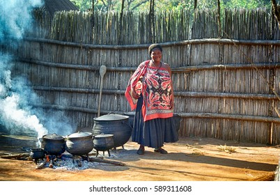 SWAZILAND - JULY 15: Swazi woman on 15 July 2000 at Swaziland. Some of the Swazi people are still living in small, remote villages.