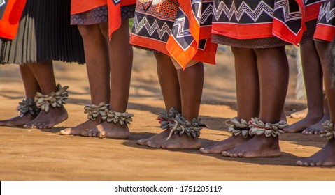 SWAZILAND, MANTENGA - July 2019 bare feet of Swazi woman dancers with handmade rattles during traditional singing and dancing with traditional attire/clothing, tourist season.