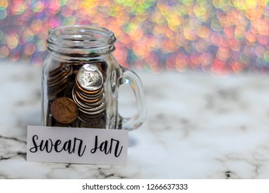 Swear Jar challenge concept with glass jar filled with coins, simple background