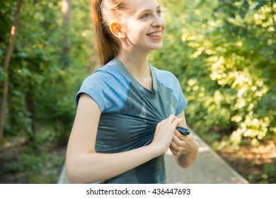 sweat woman smiling after a workout running in park