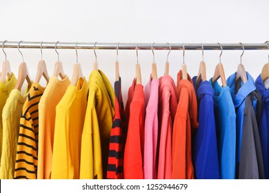 Sweater clothes with sports warm jacket.,colorful , stripy clothes on hanging