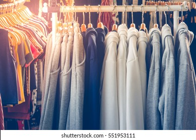 Sweaters Hanging on Metal Clothes Rack