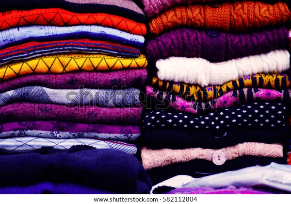 Sweaters on the flea market in New Delhi, India. Pattern, background.