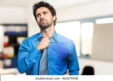 Sweating businessman due to hot climate