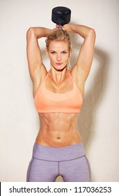 Sweating female athlete working out in the gym