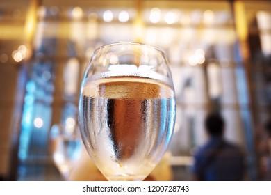 sweating glass of water, moisture bead