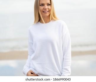Sweatshirt mockup with lifestyle model on the beach.