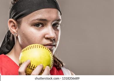 Sweaty girl holding ball