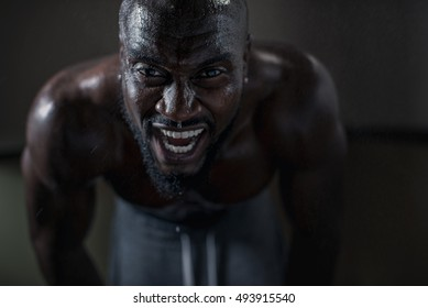 Sweaty man during intense workout.