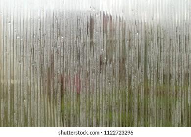 A sweaty polycarbonate sheet. Polycarbonate cellular transparent. Close-up. Background. Texture.