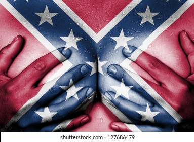 Sweaty upper part of female body, hands covering breasts, confederate flag