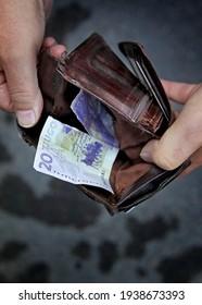 LINKÖPING, SWEDEN- 7 SEPTEMBER 2012:  Wallet with a twenty kronor note in it. Photo Jeppe Gustafsson