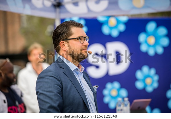 Umeå, Sweden - August 14, 2018. Sweden Democrats' Square Meeting in Umeå. Jimmie Åkesson speaks to the people on the city square where opposition left-wingers have formed a chain and protest