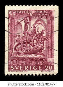 SWEDEN - CIRCA 1962: a stamp printed in the Sweden shows medieval wooden sculpture depicting the legend of Saint George and the Dragon, located in Storkyrkan in Stockholm, Sweden, circa 1962