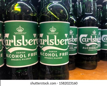 Sweden, Malmö - December 7, 2019: Bottles of Carlsberg alcohol free beer on a shelf at a supermarket