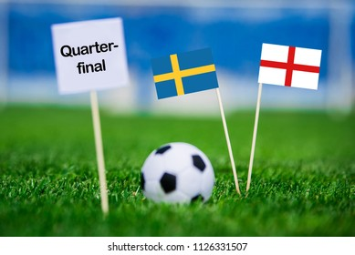 """Sweden and England national Flag on football green grass. White table with tittle """"QUARTER-FINAL"""" Sweden - England, Quarterfinal, 7. July, Football match."""