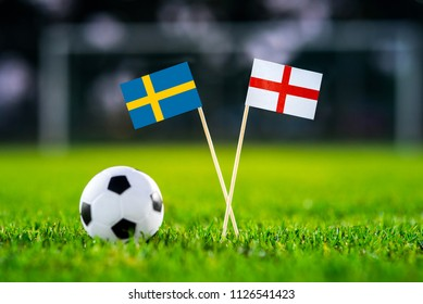 Sweden and England national Flag on football green grass. Sweden - England, Quarterfinal, 7. July, Football match.