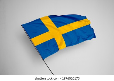 Sweden flag isolated on white background with clipping path. close up waving flag of Sweden. flag symbols of Sweden. Sweden flag frame with empty space for your text.