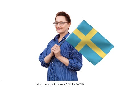 Sweden flag. Woman holding Swedish flag. Nice portrait of middle aged lady 40 50 years old holding a large flag isolated on white background.