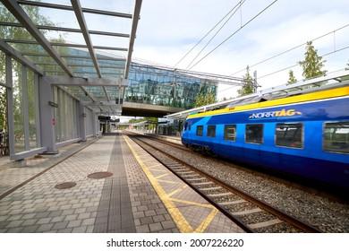 Umeå, Sweden - Jun 17, 2021: Norrtåg commuter train arriving at Umea East (Umeå Östra) train station, captured with motion blur. Norrtag is responsible for the regional and commuter trains in Northlan