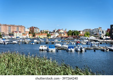 Sweden, Karlskrona: Panoramic view of Swedish town with central marina, water, boats, pier and buildings at Baltic Sea. July 07, 2014