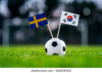 Sweden - Korea Republic, South Korea, Group F, Monday, 18. June, Football,  National Flags on green grass, white football ball on ground.