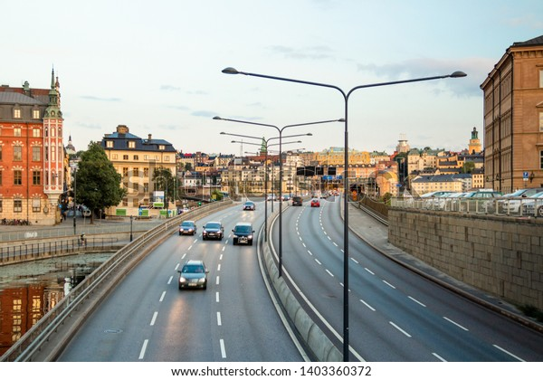 SWEDEN, STOCKHOLM - CIRCA AUG 2013: Cityscape view on highway in the old town city center, ?ars on the road.