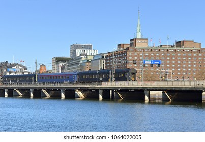 SWEDEN, STOCKHOLM - MARCH 27, 2018: Train on Central Bridge (Centralbron) on background of Sheraton hotel. Spring