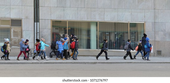 SWEDEN, STOCKHOLM - MARCH 27, 2018: School students going on city street