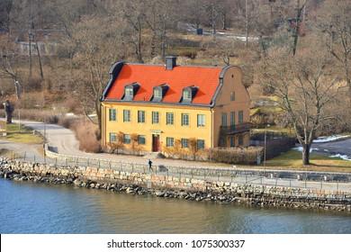 SWEDEN, STOCKHOLM - MARCH 27, 2018: Stockholm archipelago. Old yellow house